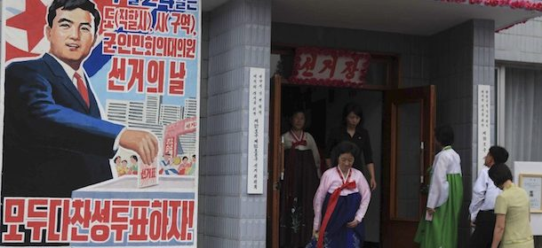 Voters coming and going at the entrance to a polling station in Pyongyang, as North Korea held elections for provincial, city, and county people's assemblies Sunday, July 24, 2011 (AP Photo/APTN)