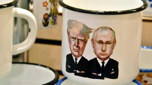 "A picture taken on July 5, 2017 shows a souvenir shops offering among others cup a tin mug depicting Russian President Vladimir Putin and US President Donald Trump, in Moscow. It was a constant refrain on the campaign trail for Donald Trump in his quest for the US presidency: ""We're going to have a great relationship with Putin and Russia."" Now, weighed down by claims that Moscow helped put him in the White House, Trump is set to finally meet his Russian counterpart in an encounter fraught with potential danger for the struggling American leader. / AFP PHOTO / Mladen ANTONOV"